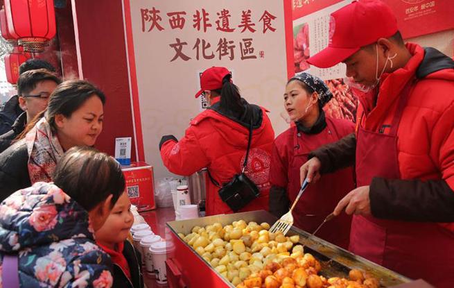 大唐不夜城汇聚各路美食 舌尖上品味传统中国年