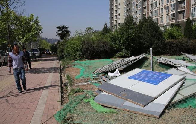 西安一小区楼下绿化带要建公厕遭业主反对 城管呼吁理解